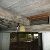 Unprotected-Electrical-Cables-on-underfloor-Beam
