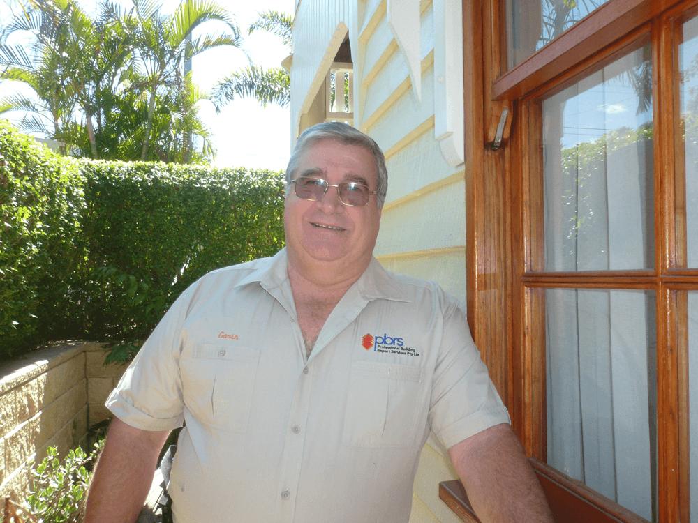 Gavin Inspecting House Exterior